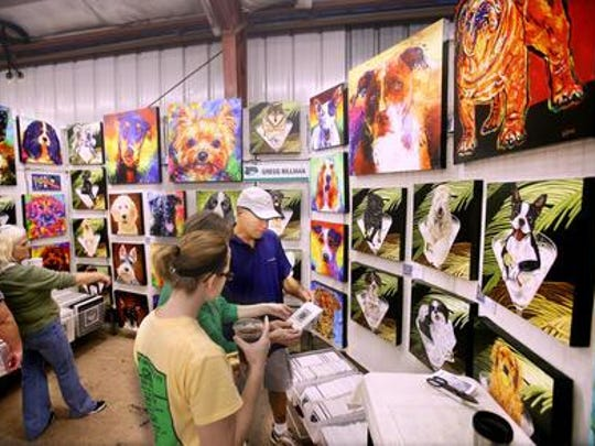 Shoppers peruse​ art during Market Days.