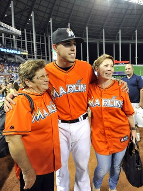 Fernandez (center) poses for a photograph with grandmother