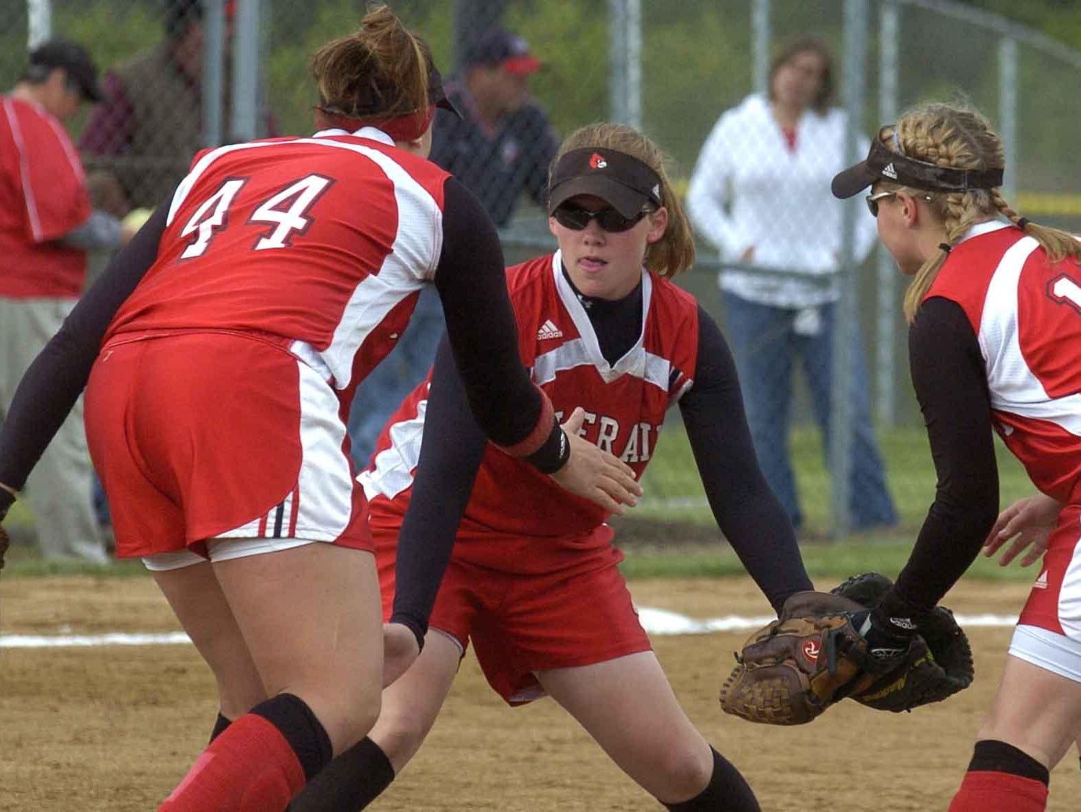From left, Colerain's Jenna Suttles (44), pitcher Emily Schwaeble (10) and Andrea Amrein (17) celebrates after getting the second out in the 7th inning at Lakota East softball field in 2007.