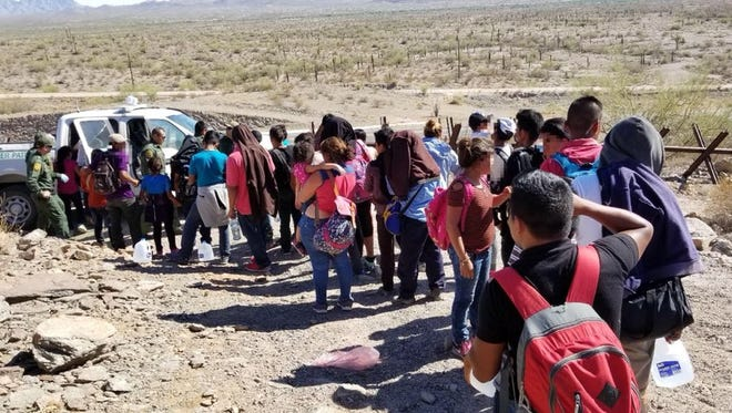 Migrants suffering from dehydration were rescued, then arrested in 108-degree weather near Lukeville, Arizona, on June 22, 2018.