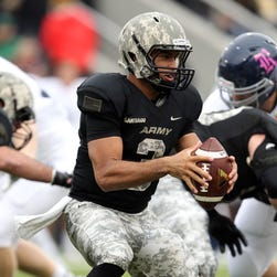 Army Black Knights quarterback Angel Santiago (3) looks to hand off during the first quarter against Rice at Michie Stadium.