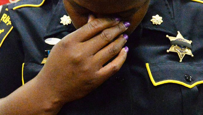 Machete Harris from the Bossier Sheriff department gets emotional during the prayer service held at the Bossier Sheriff Substation Friday afternoon.