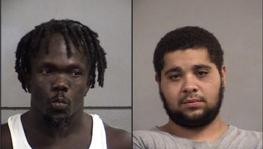 Ray Edwards, left, and Donnell Mitchell, right, were arrested and charged with drug trafficking after a one-vehicle crash in a stolen car near the Louisville International Airport.