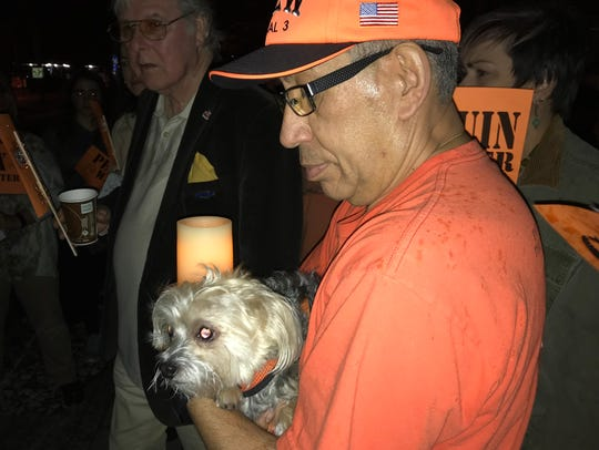 Juan Melendez of Garfield holds Snoopy and a candle