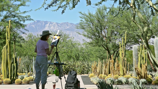 An artist paints at Sunnylands, which will host President Barack Obama and the leaders of Southeast Asian nations.