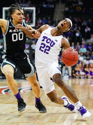 Kansas State guard Mike McGuirl (00) defends against TCU's RJ Nembhard (22) during a Big 12 Tournament game last March in Kansas City. McGuirl is one of two returning starters for the Wildcats.