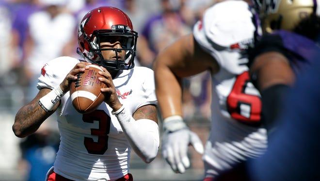 Eastern Washington quarterback Vernon Adams Jr. looks to throw against Washington.