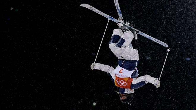 Morgan Schild, of the United States, jumps during the women's moguls finals at Phoenix Snow Park at the 2018 Winter Olympics in Pyeongchang, South Korea, on Sunday.