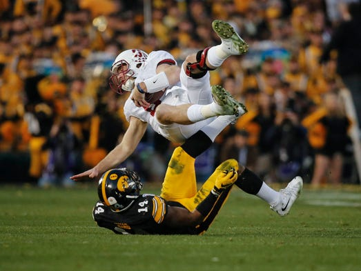 Iowa safety Desmond King upends Stanford quarterback