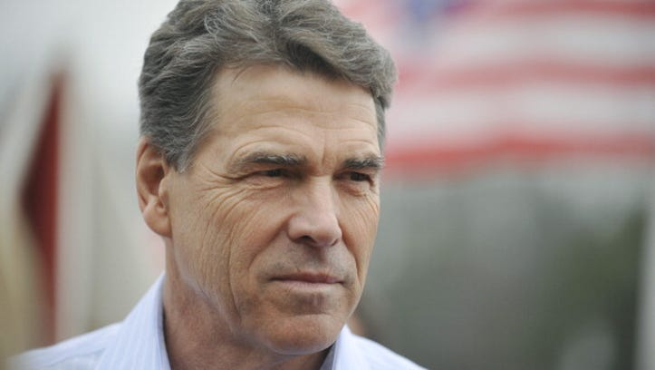 SPARTANBURG, SC- JANUARY 8:  Republican presidential candidate, Texas Gov. Rick Perry greets supporters during a campaign stop at the Beacon Drive-In January 8, 2012 in Spartanburg, South Carolina. After suffering a fifth place finish in the Iowa caucuses, Gov. Perry has returned to the campaign trail in South Carolina with events for the next several days in hopes of keeping his candidacy alive.  (Photo by Rainier Ehrhardt/Getty Images)