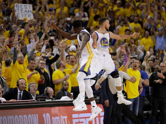 FILE - In this June 12, 2017, file photo, Golden State Warriors forward Draymond Green, left, and guard Stephen Curry (30) celebrate during the second half of Game 5 of basketball's NBA Finals against the Cleveland Cavaliers in Oakland, Calif. Winners of the NBA title in two of the last three seasons, Golden State made it look easy at times a year ago and prevailed in 31 of their final 33 games.  (AP Photo/Marcio Jose Sanchez, File)