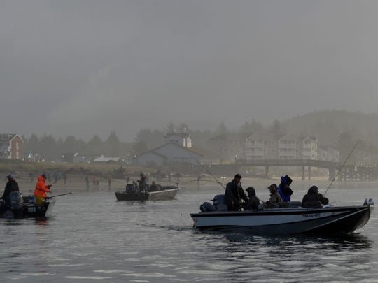 A cluster of boats trolls for salmon on the incoming