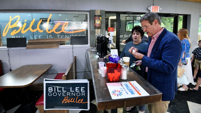 Gubernatorial candidate Bill Lee grabs a coffee before getting on his campaign RV after a town hall meeting at SoKno Market in South Knoxville on June 28, 2018.