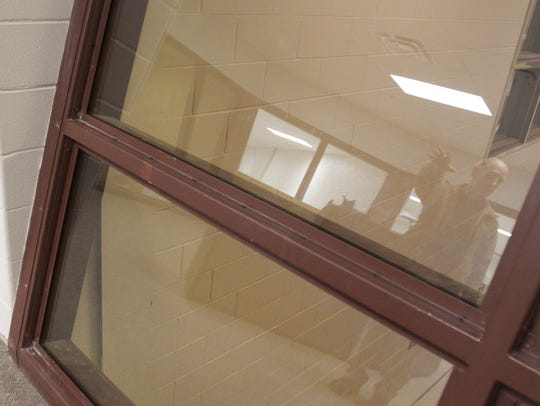 Special smoke glass panels, mounted in tilted frames