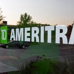 In this July 18, 2010, file photo, a TD Ameritrade logo is displayed on the office in Omaha, Neb. Online brokerage TD Ameritrade is buying Scottrade Financial Services Inc., announced Monday, Oct. 24, 2016, in a cash-and-stock deal valued at about $4 billion, which will help bolster its retail business and more than quadruple the size of its branch network. (AP Photo/Nati Harnik, File)