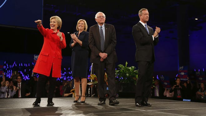 Democratic presidential candidates Hillary Clinton, Bernie Sanders and Martin O'Malley are introduced by Dr. Andy McGuire during the 2015 Jefferson-Jackson Dinner on Saturday, Oct. 24, 2015, in Des Moines, Iowa.