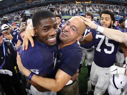 ARLINGTON, TEXAS - DECEMBER 28: Head coach James Franklin of the Penn State Nittany Lions celebrates with Cam Brown #6 of the Penn State Nittany Lions after the Nittany Lions beat the Memphis Tigers 53-39 at AT&T Stadium on December 28, 2019 in Arlington, Texas. (Photo by Tom Pennington/Getty Images)