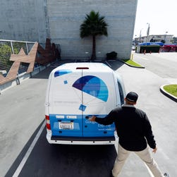A Google Shopping Express van is seen at Google headquarters on May 5, 2014, in Los Angeles, California.
