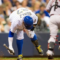 Milwaukee Brewers center fielder Carlos Gomez (27) breaks his bat after striking out during the eighth inning against the Arizona Diamondbacks at Miller Park.