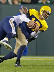 Green Bay Packers quarterback Aaron Rodgers (12) is sacked in the fourth quarter at Lambeau Field.