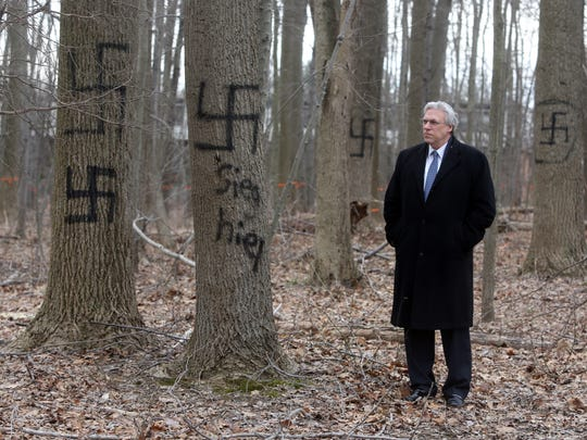 Rabbi David Berkman, senior rabbi at the New City Jewish Center, stands near trees spray painted with swastikas Feb. 3, 2017. The graffiti, on a dozen trees in woods located off Cragmere Oval and Cranford Drive in New City, includes racist and other anti-semitic markings. It was first reported to the Clarkstown police last July.