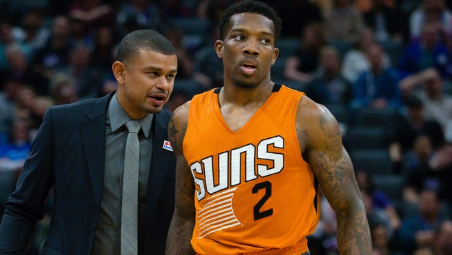 Phoenix Suns head coach Earl Watson speaks to guard Eric Bledsoe (2) during the third quarter against the Sacramento Kings at Golden 1 Center.