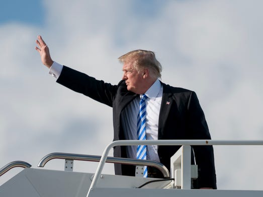 President Trump boards Air Force One at Palm Beach