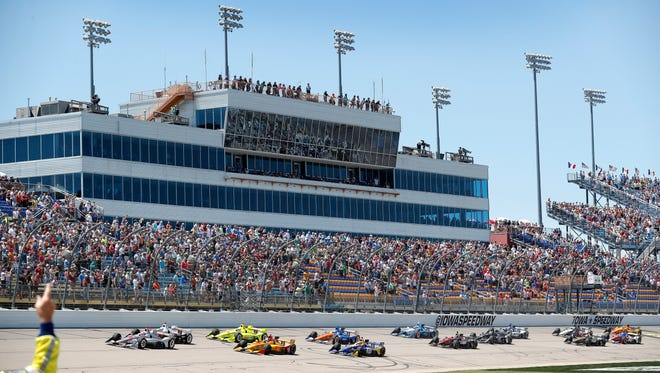 Will Power, left, leads the field during the opening lap of the IndyCar Series auto race, Sunday, July 8, 2018, at Iowa Speedway in Newton, Iowa.