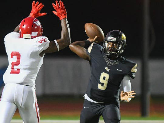 Northwest Rankin quarterback Jamari Jones (9) throws a pass against Warren Central as Lamar Gray Jr (2) moves in during game action Friday in Flowood.
