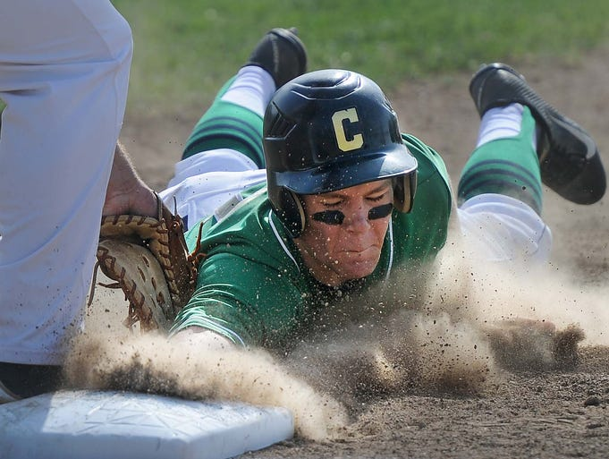 Cathedral's Harry Shipley is picked off at first base as Scecina first baseman Sam Burck applies the tag. Scecina hosted Cathedral in high school baseball Monday May 5, 2014.