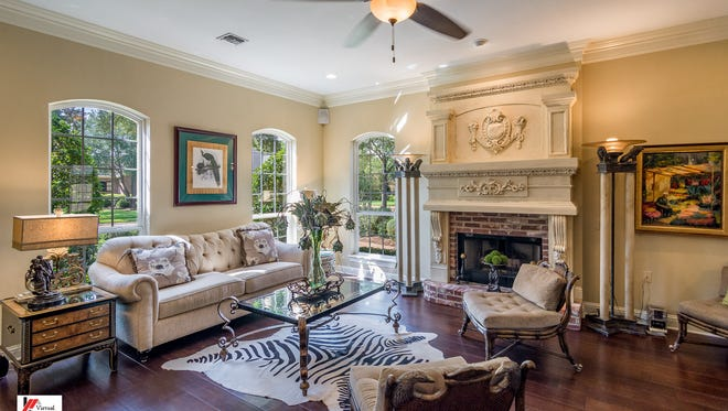 The living room at 201 Claremore Circle in Bossier City features custom touches.