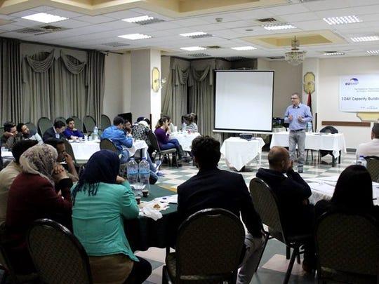 Nidal Fuqaha speaking at a PPC youth leaders seminar