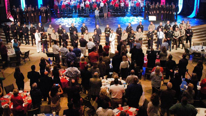 """Country music artist Lee Greenwood sings his signature patriotic anthem """"God Bless the USA"""" at Long Hollow Baptist Church in Hendersonville on Oct. 6 as a guest of the Hendersonville Area Chamber of Commerce."""