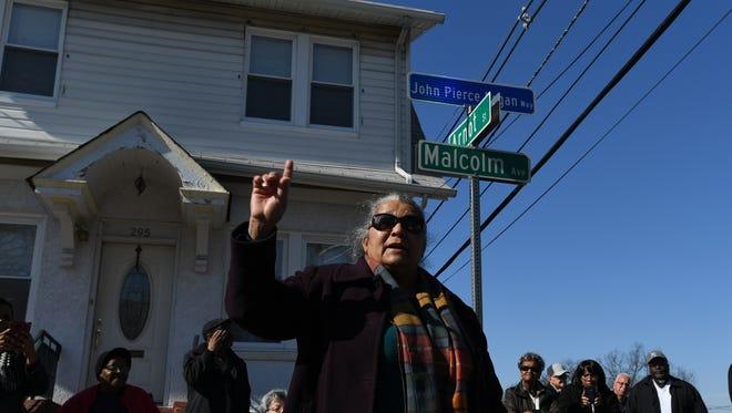 Street dedication for John P. Logan at the intersection of Malcolm Avenue and Arnot Street in Garfield on Saturday, Feb. 18, 2017. John P. Logan's daughter, Venita Allen, speaks during the dedication.