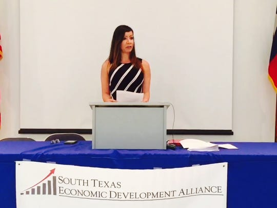 Marisa Yvette Utley, economic and community development consultant for the South Texas Economic Development Alliance, speaks during a press conference Monday. The alliance threw its support behind a plan to open a 200-acre crude oil refinery plant in Duval County.