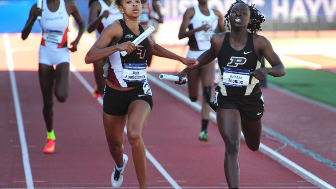 Purdue's Brionna Thomas is edged to the line by Florida State's Kala Funderburk in the 4x400 meter relay.