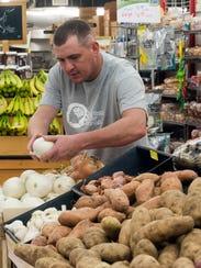 Apple Market customer, Greg Schnoor, shops the produce