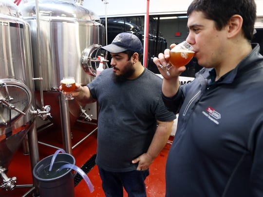 Andrew, l,  and Thomas Aslanian, two of three brothers, owners of Fort Nonsense Brewing sample their amber ale, the brothers are opening the townshipÕs first brewery soon in Denville. January 10, 2018. Denville, NJ.