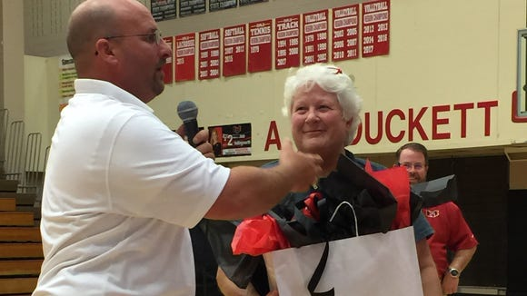 Hillcrest athletic director Tommy Bell, left, presents Lynn Avant, who's retirning after 21 seasons as the Rams' volleyball coach, with a gift during a ceremony following Thursday night's Hillcrest win over Fort Mill in the first round of the Class AAAAA playoffs.