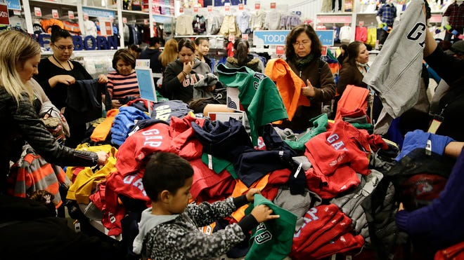 People shop at a Gap factory store at the Citadel Outlets on Nov. 28, 2013, in Los Angeles. Instead of waiting for Black Friday, which is typically the year's biggest shopping day, more than a dozen major retailers opened on Thanksgiving Day this year.