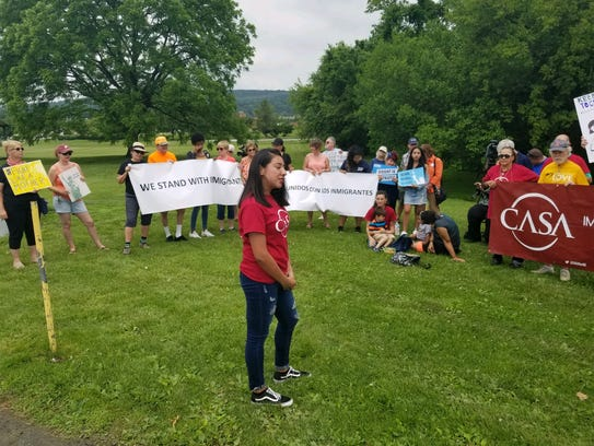 Arlette Gonzalez, a York City resident who immigrated from Mexico with her family at 2 years old, spoke to a crowd by the York County Prison Immigration Facility during a vigil for immigrant children separated from their families.
