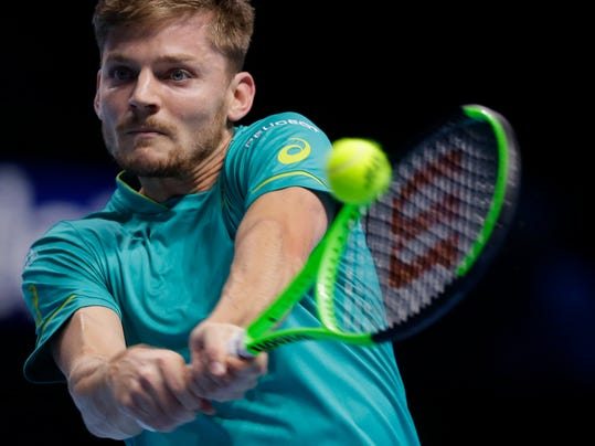 David Goffin of Belgium plays a return to Dominic Thiem of Austria during their mens singles tennis match at the ATP World Finals at the O2 Arena in London, Friday, Nov. 17, 2017. (AP Photo/Alastair Grant)