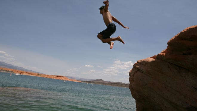 Omar Andrade leaps from a rock and into the waters of Sand Hollow Reservoir, which will host Boardfest 2015 from June 19-21.
