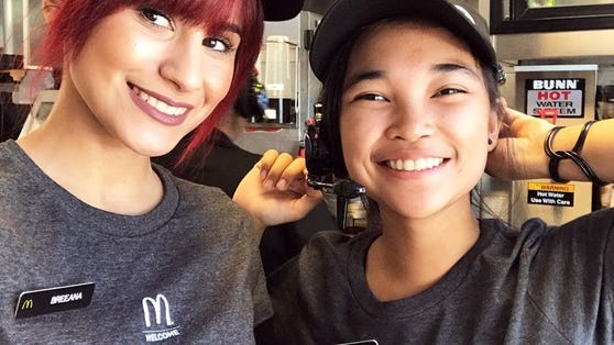 Two smiling female McDonald's employees