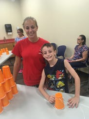 Kasey McDaniel, 16, and Aaron McDaniel, 10, enjoy activities