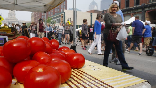 Fresh ripe tomatoes entice customers during the opening day of the 2016 downtown farmers market in Des Moines.