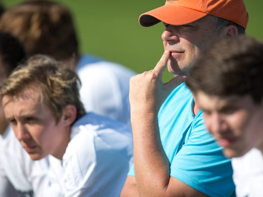 Roosevelt High School assistant coach Sean Holmes watches their team play Lincoln on Tuesday at Cownie Soccer Complex in Des Moines.