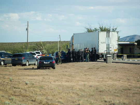 Las Cruces and New Mexico state police officers gather at a potential crime scene, the southbound Interstate 25 rest stop near the U.S. Border Patrol checkpoint on Friday, Aug. 12, 2016.