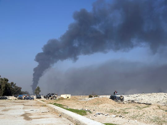 Smoke rises Iraqi security forces deploy inside Mosul's