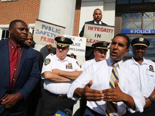 Mayor Richard Thomas responds to a news conference